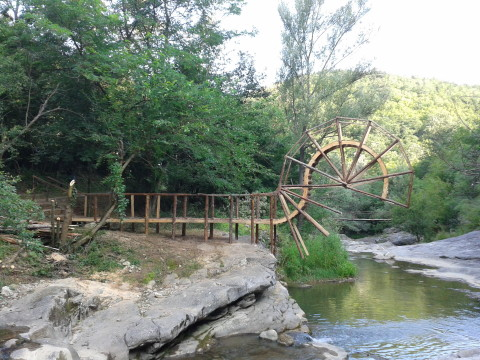 """Startled bridge"",2013, wood, 430 x 1400 x 100 cm, Duppini Art Group Art-Nature Symposium, Gabrovtsi, Bulgaria."