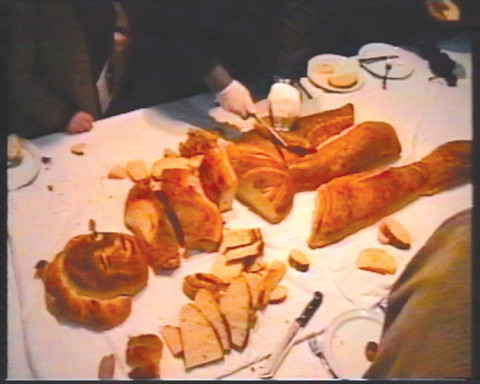 """On the table"",2002 Installation Bread by Tanya Preminger, table, plates, glasses, cutlery Artists house, Tel Aviv Video from performance"