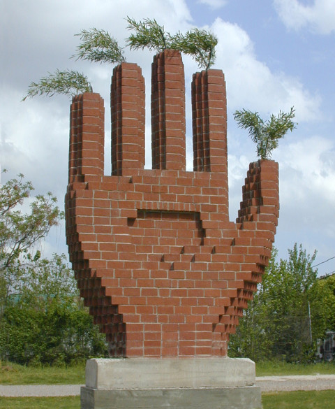 """Salute"". 2002. Bricks, concrete, iron, trees. 400 x 260 x 70 cm. Houston, USA."