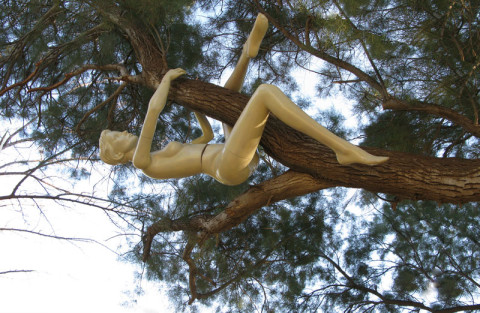 """Back to the Trees"". 2009.Israel.  Tree, Plastic mannequin. 60x150x100 cm. Park Dina."